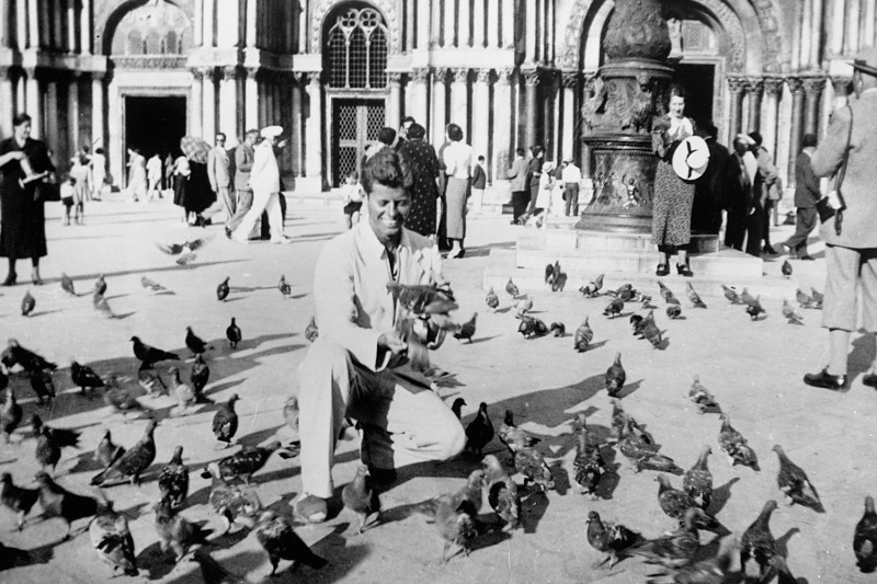 John F. Kennedy feeds the pigeons at the Piazza San Marco in Venice circa 1937.
