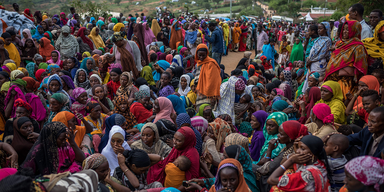 Ethiopian refugee women wait to receiveitems distributed by the Kenyan Red Cross at the newly built Somare refugee camp in Moyale, Kenya, on March 19, 2018.