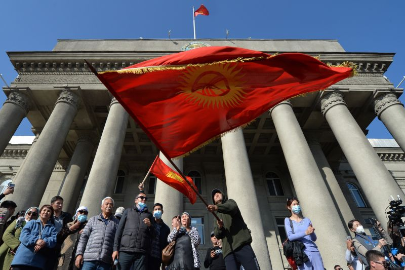 Supporters of newly appointed Prime Minister Sadyr Japarov wave Kyrgyz flags during a rally in support of Japarov in Bishkek on Oct. 14.