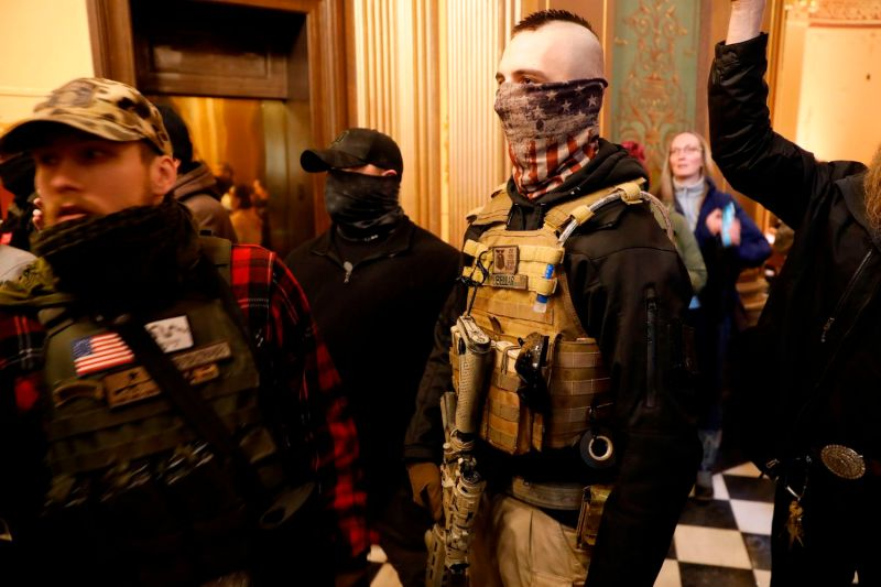 Protesters try to enter the Michigan House of Representatives chamber and are kept out by State Police at the Michigan State Capitol in Lansing, Michigan on April 30.
