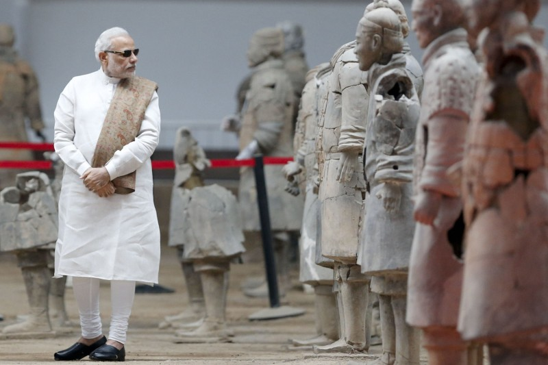 Indian Prime Minister Narendra Modi looks at sculptures of the terra-cotta army in China's Shaanxi province on May 14, 2015.