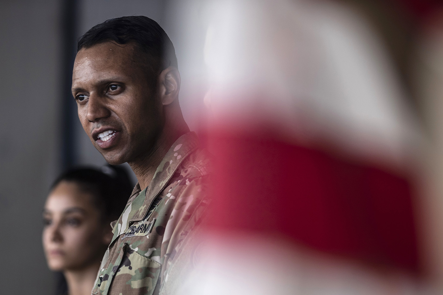 U.S. Army Col. Myles Caggins, then official military spokesperson for international military intervention against the Islamic State, speaks at a military base in Rumaylan in Syria's northeastern Hasakeh province on July 28.