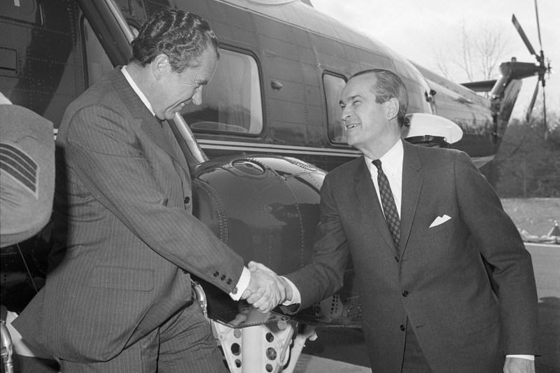 U.S. President Richard Nixon shakes hands with CIA Director Richard Helms