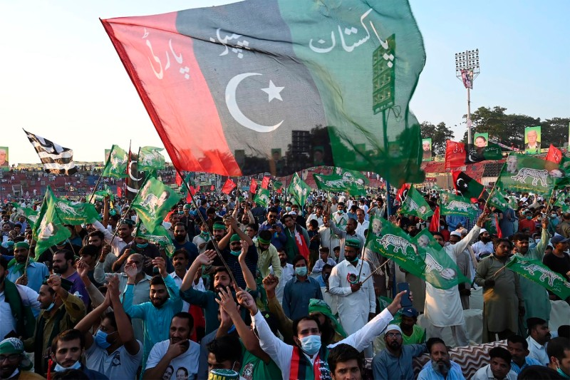 Activists from the newly-formed Pakistan Democratic Movement (PDM), an opposition alliance of 11 parties, wave parties flags during the first public rally in Gujranwala, Pakistan, on Oct. 16. ober 16, 2020.