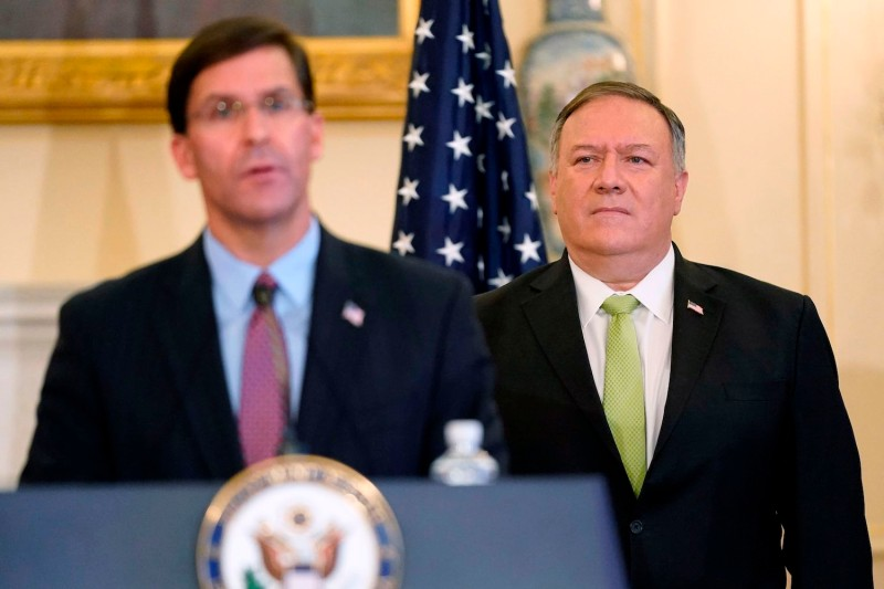 U.S. Defense Secretary Mark Esper speaks during a news conference as U.S. Secretary of State Mike Pompeo listens during the announcement of the Trump administration's restoration of sanctions on Iran.