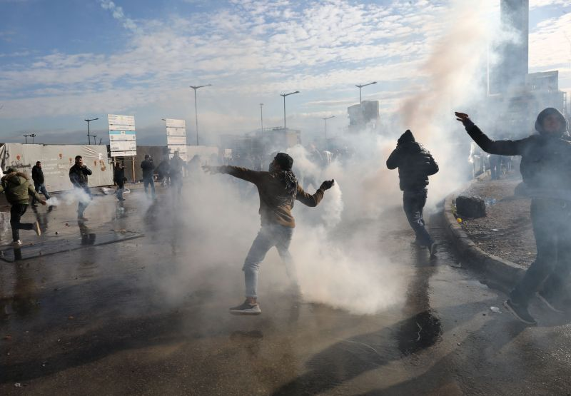 Lebanese demonstrators protest against the government's handling of a collapsing economy, with Lebanon burdened by debt of nearly $90 billion, on Feb. 11, 2020 in Beirut.