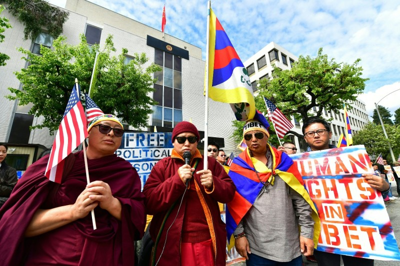 Tibetan flags are displayed as protesters gather in front of the Consulate General of China in Los Angeles on March 10, 2019, to mark the 60th Global Tibetan National Uprising Commemorations.