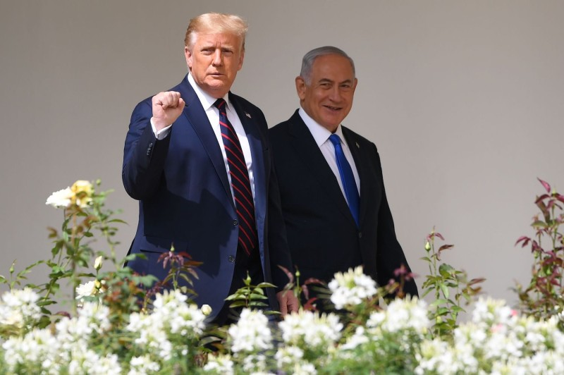 U.S. President Donald Trump arrives with Israeli Prime Minister Benjamin Netanyahu for the the signing of the Abraham Accords with Bahrain and the United Arab Emirates at the White House on Sept. 15.