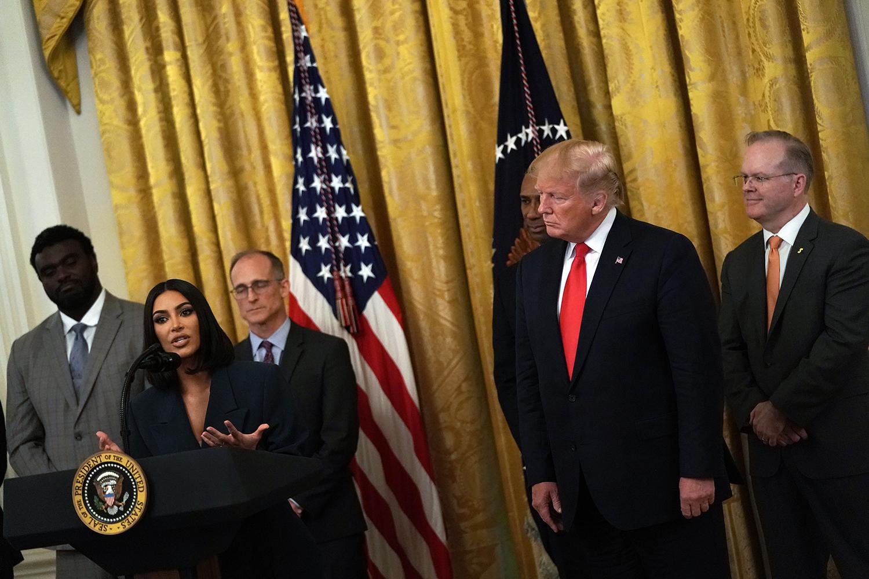 Kim Kardashian West speaks as U.S. President Donald Trump listens