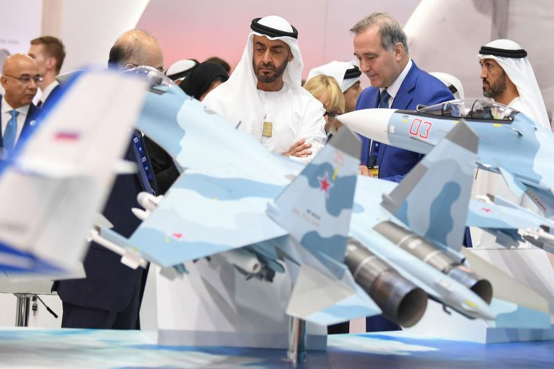 Abu Dhabi Crown Prince Sheikh Mohammed bin Zayed Al-Nahyan (C) listens to a representative at the Russian pavilion during a visit to the Dubai Airshow on Nov. 17, 2019.