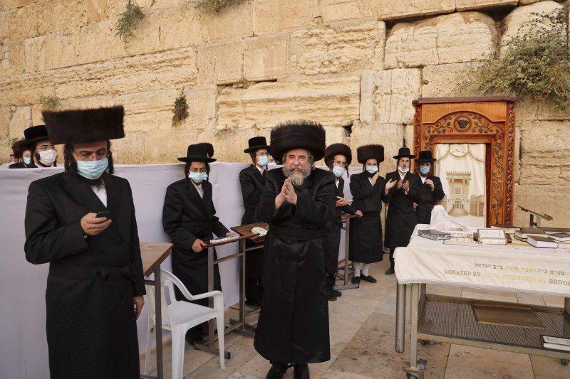 Ultra-Orthodox Jews, some wearing face masks, pray during the Sukkot holiday at the Western Wall in the old city of Jerusalem, on Oct. 7 amid Israel's second coronavirus lockdown.