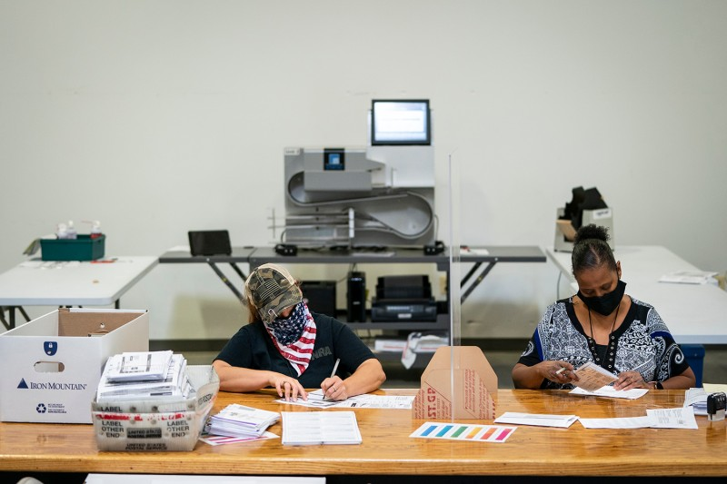 Working in bipartisan pairs, canvassers process mail-in ballots in a warehouse at the Anne Arundel County Board of Elections headquarters in Glen Burnie, Maryland, on Oct. 7.