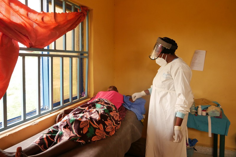 Blessing Agbo, a nurse, places a contraceptive implant for Habiba, a 30-year-old patient who didn't give her last name, in Kaugama on Aug. 13. Habiba, who has six surviving children after 10 births, says she wants to take a break from bearing children. Shola Lawal for Foreign Policy and The Fuller Project