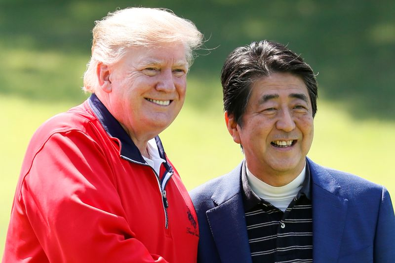 U.S. President Donald Trump is welcomed by Japanese Prime Minister Shinzo Abe