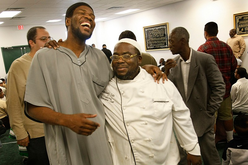 Two men share a laugh at a predominantly African American mosque in Las Vegas after U.S. President Barack Obama was elected in 2008.