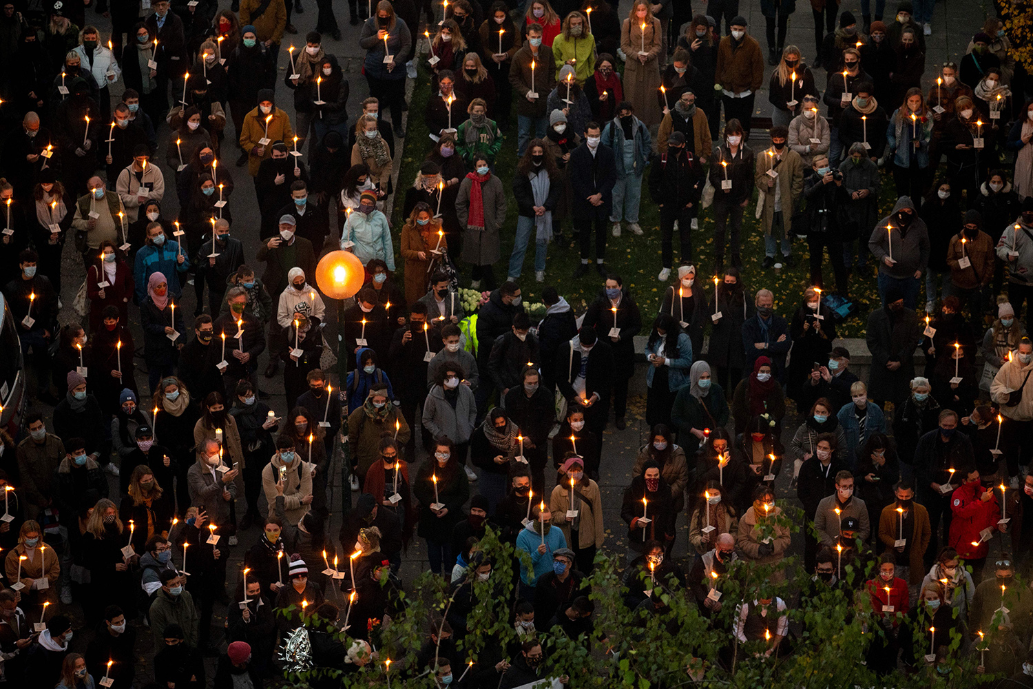 People attend a candlelight vigil for the victims of a terrorist attack in Vienna, Austria, on Nov. 5. Four people were shot dead by a man who attacked a popular nightlife area in the heart of Vienna on Nov. 2, the last night before a second coronavirus shutdown. JOE KLAMAR/AFP via Getty Images