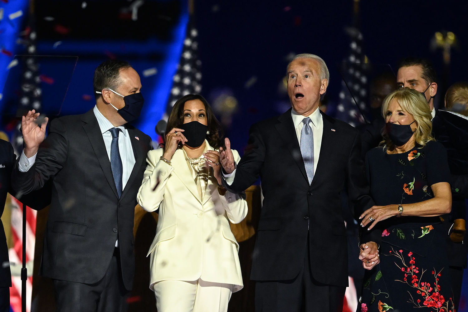 U.S. President-elect Joe Biden and Vice President-elect Kamala Harris—with their spouses Jill Biden and Doug Emhoff—react as confetti falls after delivering remarks in Wilmington, Delaware, and being declared the winners of the presidential election Nov. 7. JIM WATSON/AFP via Getty Images