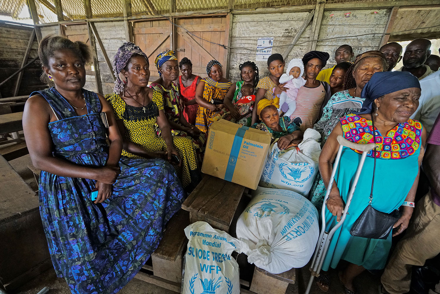 A group of women wait while a local non-governmental organization registers locally displaced residents for food aid in Buea on May 11, 2019.