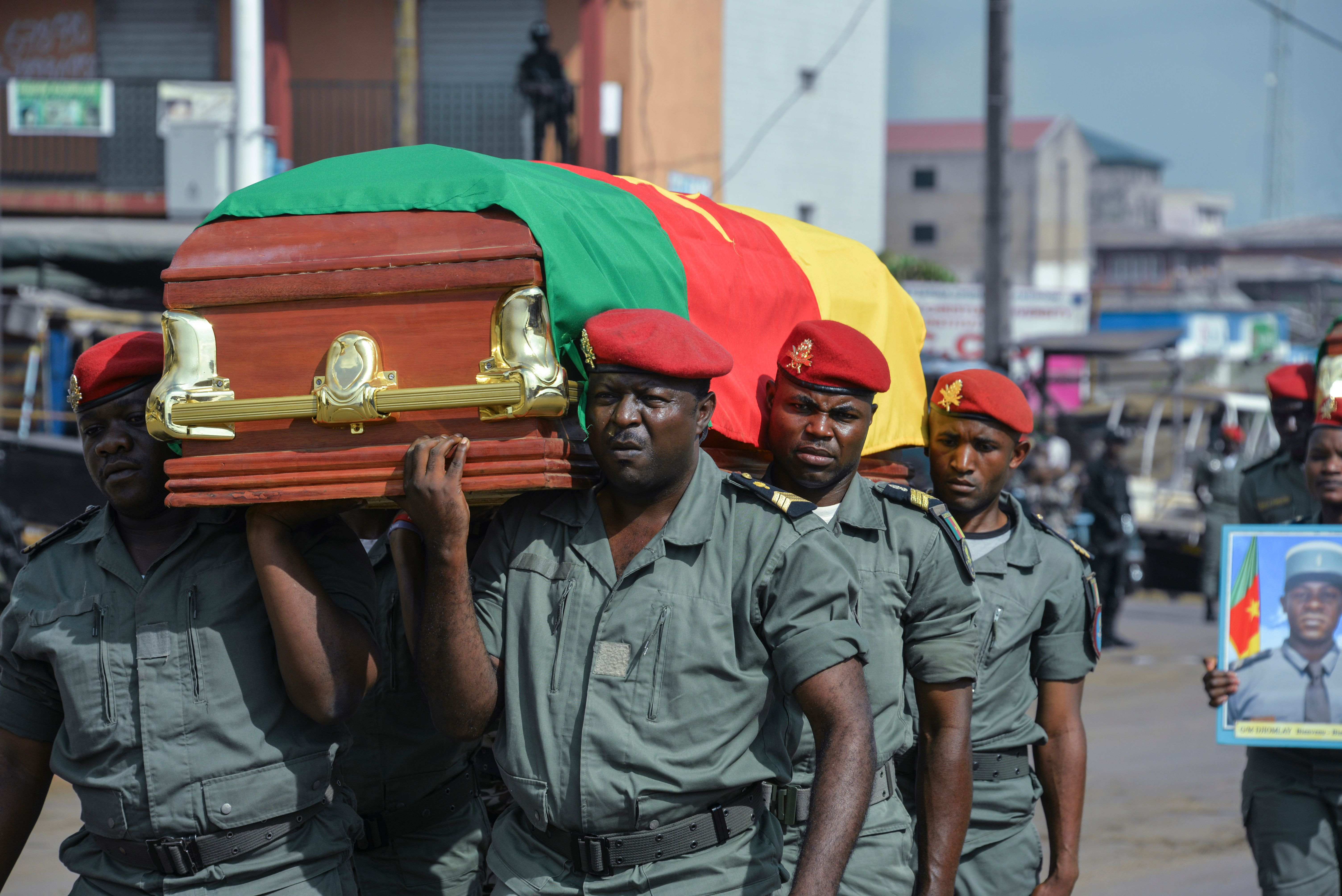 Soldiers carry the coffin of one of the four soldiers killed in the violence that erupted in the Northwest and Southwest regions of Cameroon in Bamenda on Nov. 17, 2017.