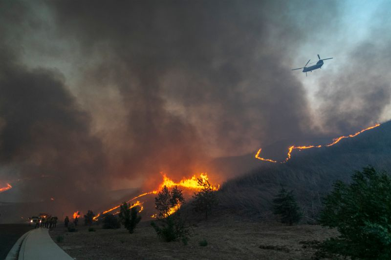 Firefighters set a backfire to protect homes in California