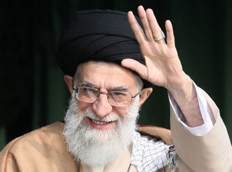 "Iranian supreme leader Ayatollah Ali Khamenei waving as he attends a gathering of Basij militia forces in Tehran. Khamenei on February 26, 2008 hailed President Mahmoud Ahmadinejad's role in the ""great success"" of the nuclear program, amid threats of new sanctions against Tehran."