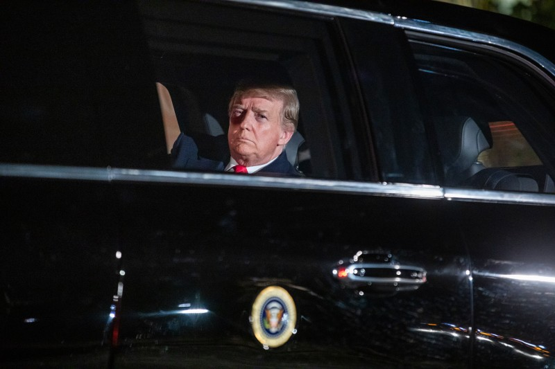President Donald Trump sits in the presidential limo as he departs the White House for Capitol Hill, where he will deliver his second State of the Union speech, on Feb. 5, 2019 in Washington.