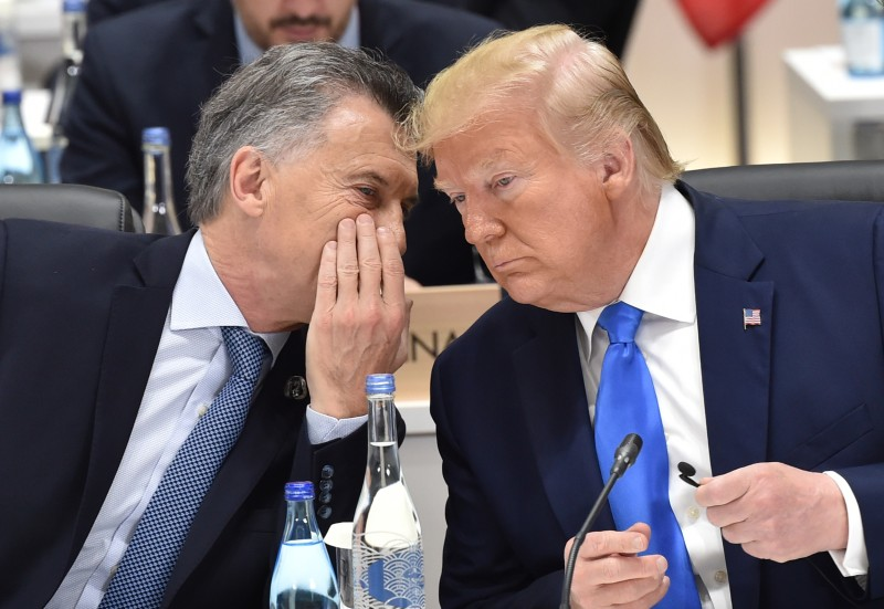 Argentina's President Mauricio Macri chats with U.S. President Donald Trump during a G20 Summit on June 29, 2019 in Osaka, Japan.