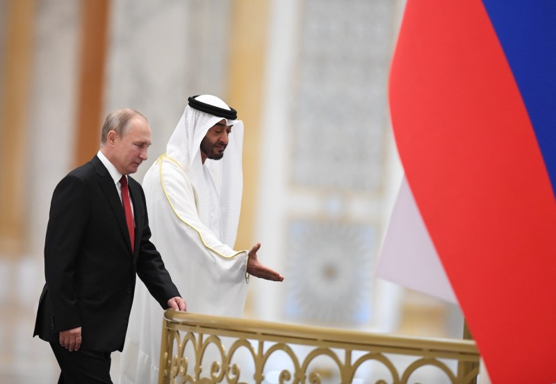 Sheikh Mohamed bin Zayed al-Nahyan, Crown Prince of Abu Dhabi, welcomes Russian President Vladimir Putin during an official ceremony in the Emirati capital's Al-Watan presidential palace on October 15, 2019.