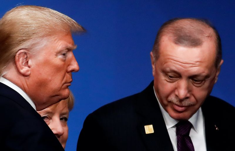 US President Donald Trump (L), Turkey's President Tayyip Erdogan (R) and Germany's Chancellor Angela Merkel (rear L) attend the NATO summit at the Grove hotel in Watford, northeast of London on December 4, 2019.