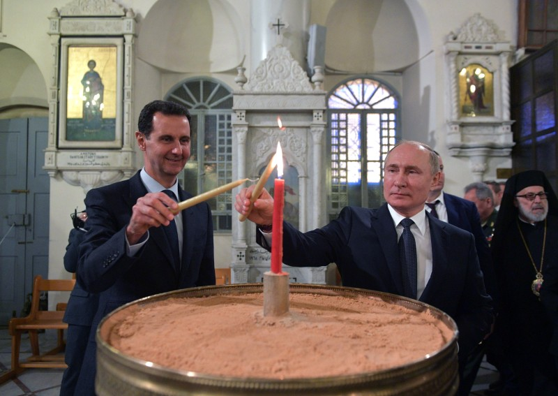 Russian President Vladimir Putin and Syrian President Bashar al-Assad visit the Mariamite Cathedral of Damascus, one of the oldest Greek Orthodox churches in the Syrian capital, in Damascus on January 7, 2020.