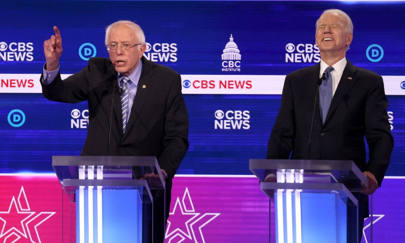 U.S. Sen. Bernie Sanders and former Vice President Joe Biden attend the Democratic presidential primary debate at the Charleston Gaillard Center in Charleston, South Carolina, on Feb. 25.