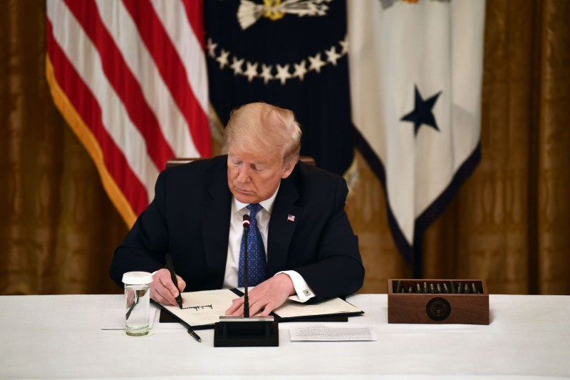 US President Donald Trump signs an executive order on May 19, 2020 in the Cabinet Room of the White House in Washington, D.C.