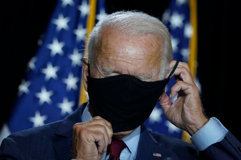 Presumptive Democratic presidential nominee former Vice President Joe Biden puts his mask back on after delivering remarks following a coronavirus briefing with health experts at the Hotel DuPont on August 13, 2020 in Wilmington, Delaware.