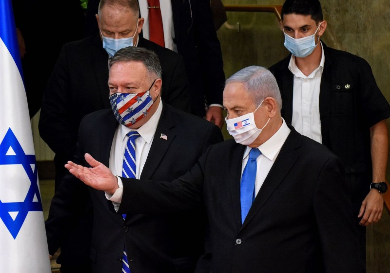 U.S. Secretary of State Mike Pompeo and Israeli Prime Minister Benjamin Netanyahu arrive wearing protective masks to make a joint statement to the press after meeting in Jerusalem, on August 24, 2020.