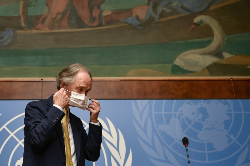 United Nations Special Envoy to Syria Geir Pedersen puts on his face mask