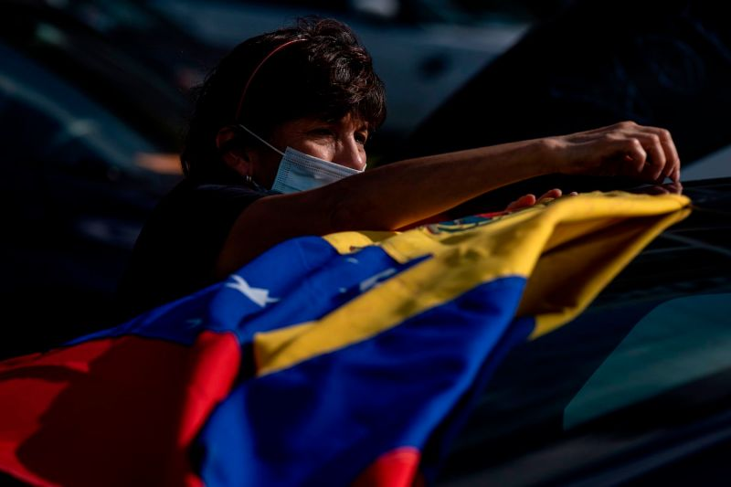 A supporter displays the Venezuelan flag at a Biden-Harris drive-in rally in Orlando, Florida on Oct. 27.