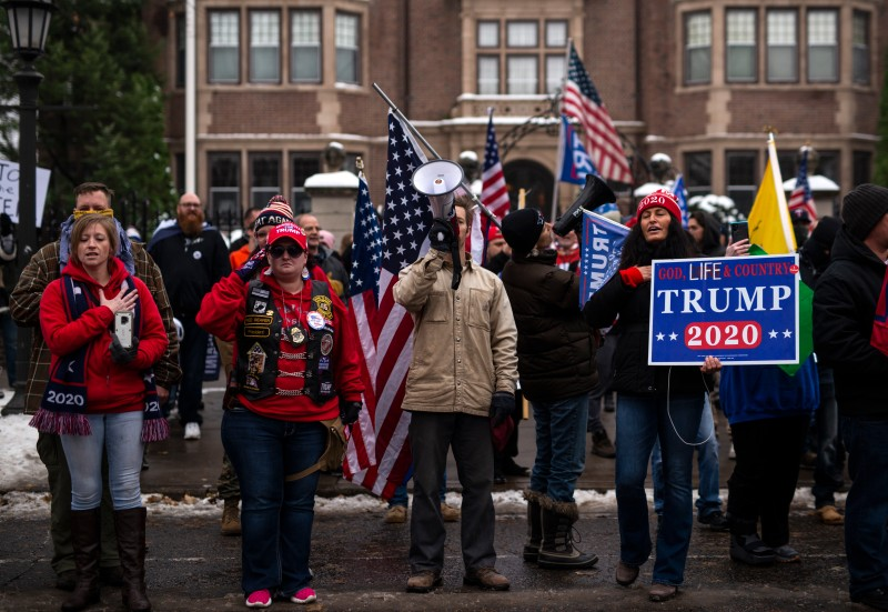 Supporters of President Donald Trump sing the national anthem during a rally outside the Governor's Mansion on November 14, 2020 in St Paul, Minnesota. Thousands have gathered in cities around the country today to contest the results of the election earlier this month. (Stephen Maturen/Getty Images)