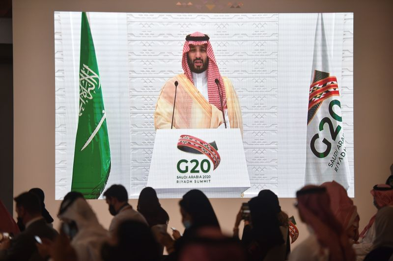Saudi and foreign media representatives listen to Saudi Crown Prince Mohammed bin Salman remotely addressing a press conference, at the G20 summit's Media Center in the capital Riyadh, on November 22, 2020.