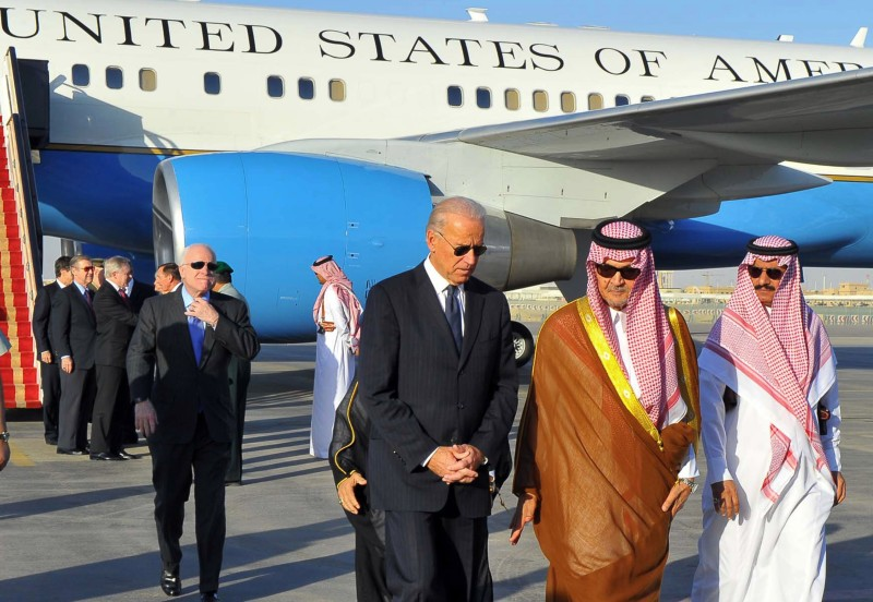 Saudi Foreign Minister Prince Saud al-Faisal  welcomes U.S. Vice President Joe Biden (C) at the Riyadh airbase on October 27, 2011, upon his arrival in the Saudi capital with a U.S. official delegation to offer condolences to the King Abdullah bin Abdul Aziz following the death of his brother, Crown Prince Sultan.