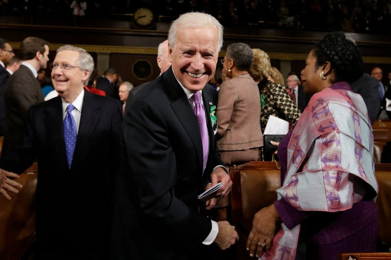 Joe Biden and Mitch McConnell arrive on Capitol Hill on Feb. 12, 2013 in Washington.