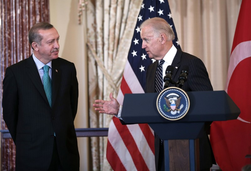 Then-U.S. Vice President Joseph Biden speaks as Turkish Prime Minister Recep Tayyip Erdogan  looks on during a luncheon at the State Department on May 16, 2013.