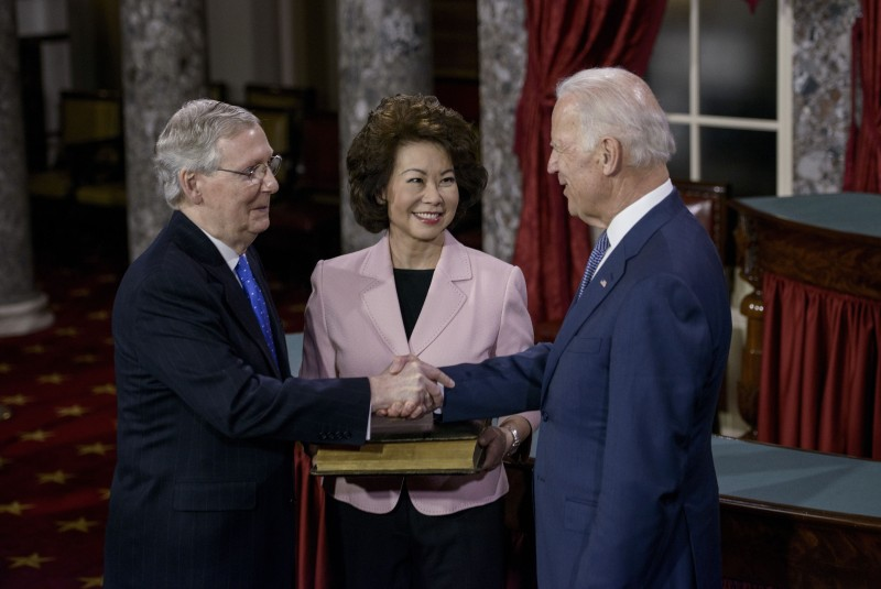 Elaine Chao (center) with her husband, Senate Majority Leader Mitch McConnell (left), and U.S. Vice President Joe Biden