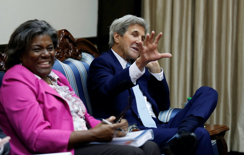 Then-US Secretary of State John Kerry (R) gestures next to Then-US Assistant Secretary of State for Africa Linda Thomas-Greenfield before their bilateral talks with Kenya's President Uhuru Kenyatta (not pictured) at the State House in Nairobi on August 22, 2016.