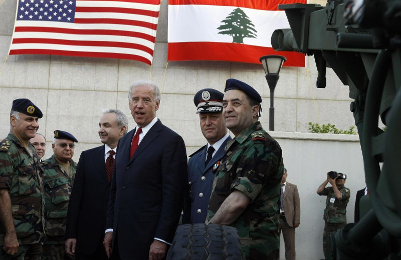 US Vice President Joe Biden and Lebanese Defence Minister Elias Murr stand with Lebanese military officers during a ceremony at the Rafiq Hariri international airport in Beirut on May 22, 2009.