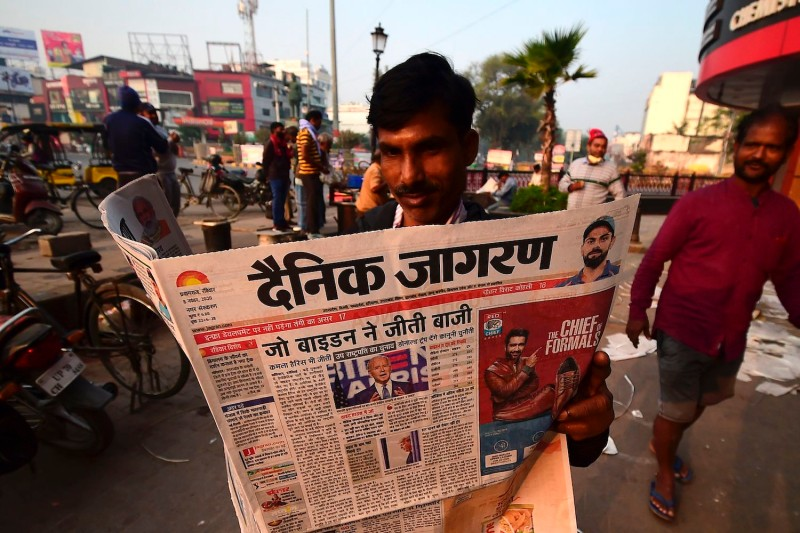 A man reads a morning newspaper showing a photograph of U.S. President-elect Joe Biden in Allahabad, India, on Nov. 8.