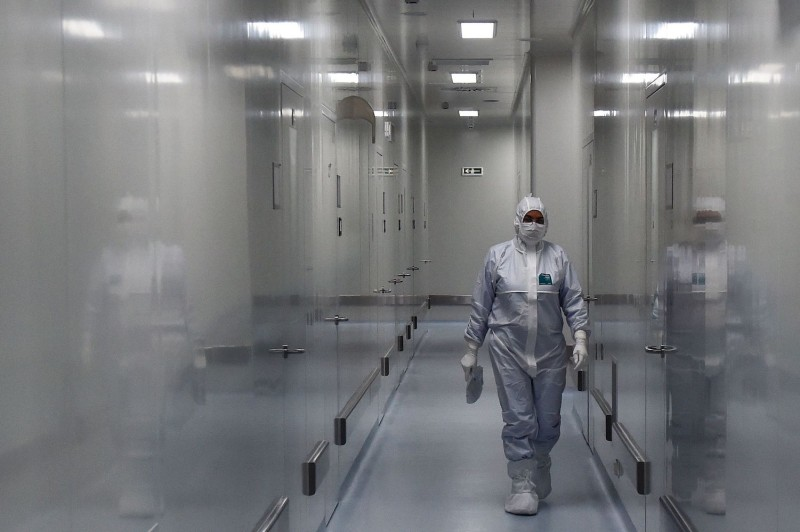 An employee wearing protective equipment is seen at the headquarters of Russia's biotech company, BIOCAD, which is developing its own COVID-19 vaccine, in Siberia, Vektor on May 20.
