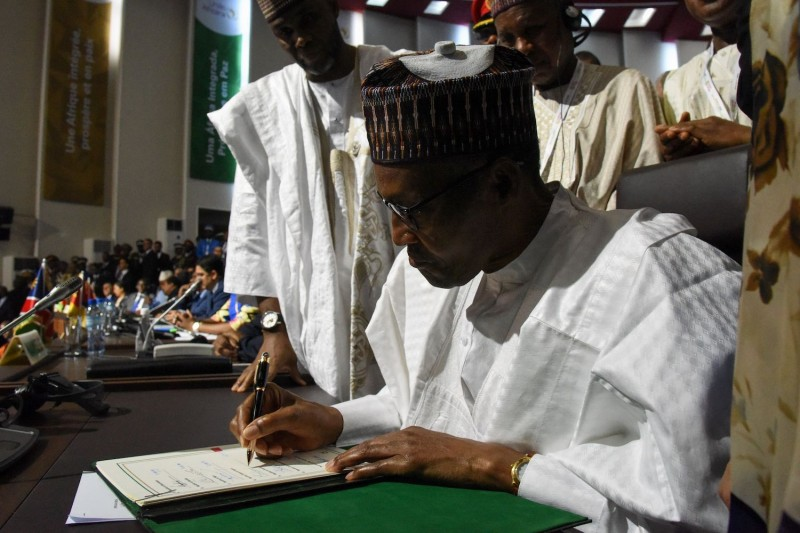 Nigerian President Muhammadu Buhari signs a landmark free trade agreement ahead of the African Union summit at the Palais des Congrès in Niamey, Niger, on July 7, 2019.