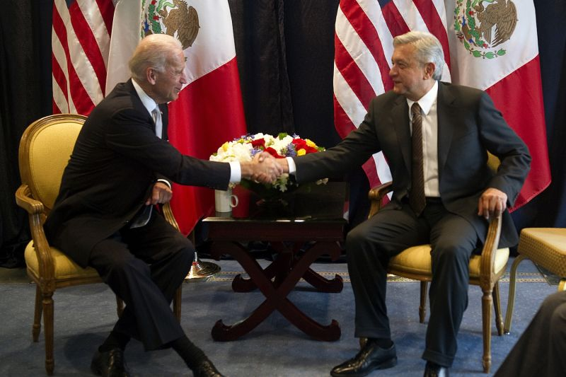 Then-U.S. Vice President Joe Biden shakes hands with Andrés Manuel López Obrador, a presidential candidate at the time, during a meeting in Mexico City on March 5, 2012.