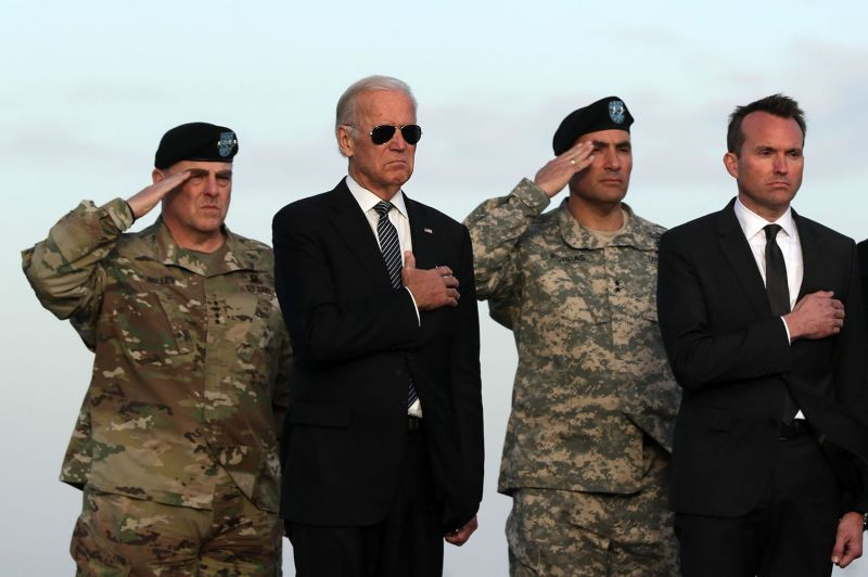 Army Chief of Staff General Mark Milley, Vice President Joe Biden, Major General Andrew P. Poppas, and Army Secretary Eric Fanning attend the transfer of a soldier who died of injuries sustained in Afghanistan in Illinois on Nov 15, 2016.