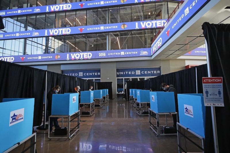 Voters use socially distanced voting machines set up in the east atrium of the United Center in Chicago on Nov. 3.